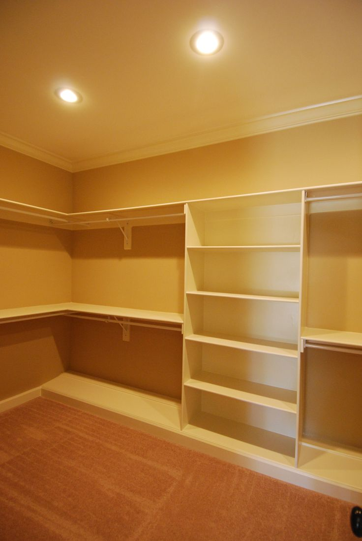 A small bedroom was converted into the Master closet. This view shows his double hanging spaces with shelving for sweaters and hats between.