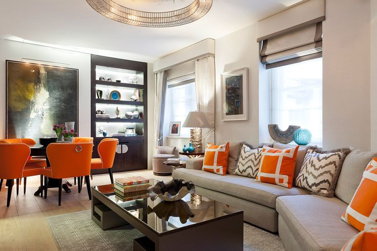 Living/Dining Rooms - Open concept with muted tones and a punch of tangerine orange .  Well design & conceived.  (re-pinned photo - Taylor Howes)