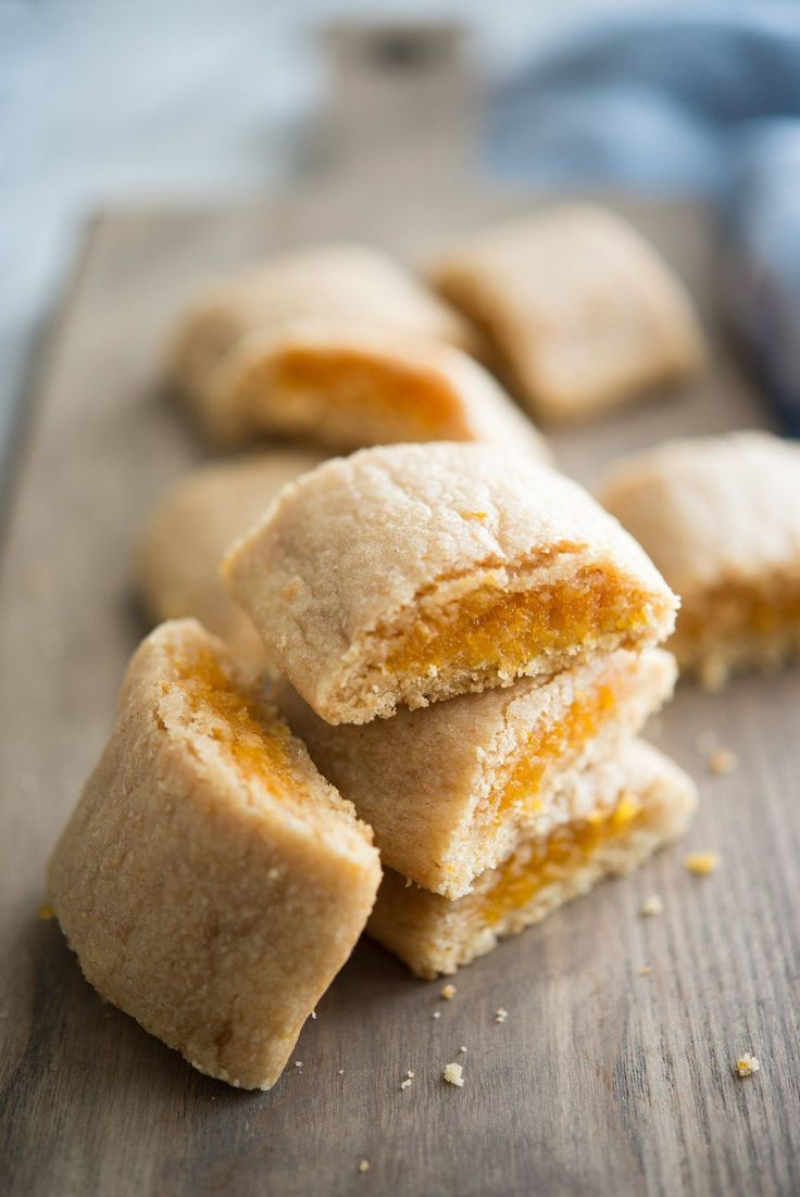 Homemade fig newtons can be flavored any way you like and are a TASTY afternoon snack for parents and kids alike! The cookies are crunchy the day they're made, but get soft overnight. Made with whole wheat flour, brown sugar, apricots, honey and a few more pantry staples.