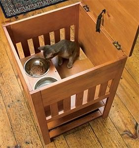 The Dog-Proof Cat Feeding Station will keep the dogs out and give your cat a secure place to eat. And you won't have to feed your kitty on the kitchen counter!s well as ventilation. In cinnamon stain. Anti-tipping hardware is included.  (Additional info/photos at http://blogs.dogtime.com/secret-shopper-pet-product-reviews/2008/11/orvis-dog-proof-feeding-station)