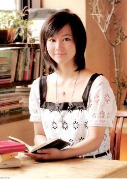 Japanese actress Maki Horikita sits with a book
