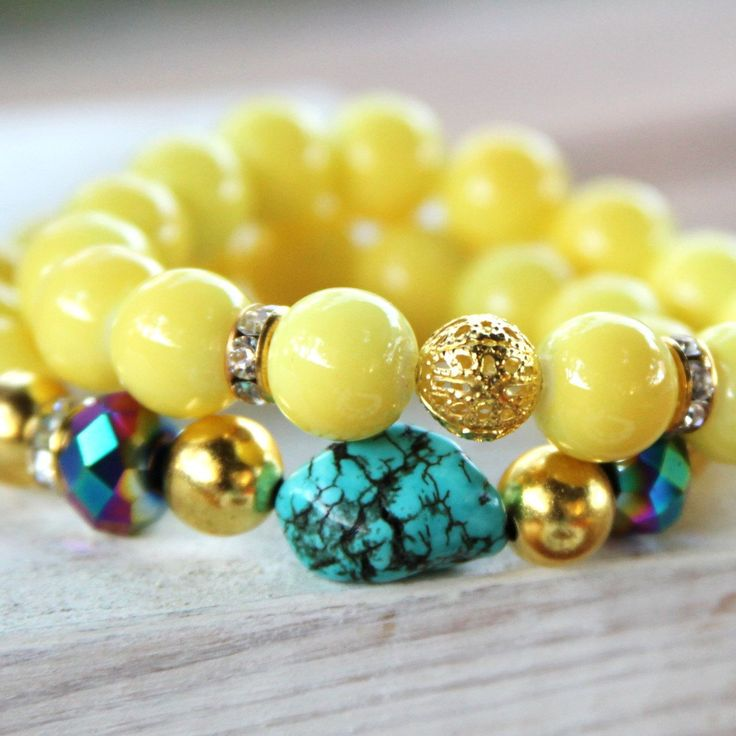 Turquoise chunk and Yellow beaded stretchy Bracelet. $15.00, via Etsy.