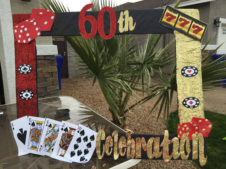 Casino theme picture frame. Photo booth frame. DIY photo booth frame. Casino party. This is made out of card board and wrapped with black tissue paper with red and gold glitter and print outs. It's made very sturdy.