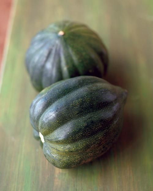 Acorn squash's buttery taste pairs well with sweet, spicy, and savory ingredients alike, from dried fruit and pork to chili powder and garlic. Here's what to look for at the market, how to store it properly, and a few great recipes.