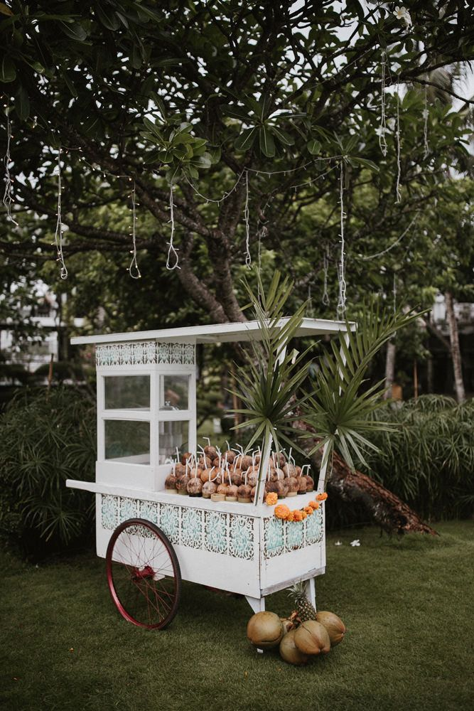 Coconut Cocktail Cart | Stylish Bali Wedding | Images by James Frost - Stylish Bali Wedding With A Fun Party Vibe With Bride In Lazaro And A Festoon Light Outdoor Reception With Images By James Frost Photography