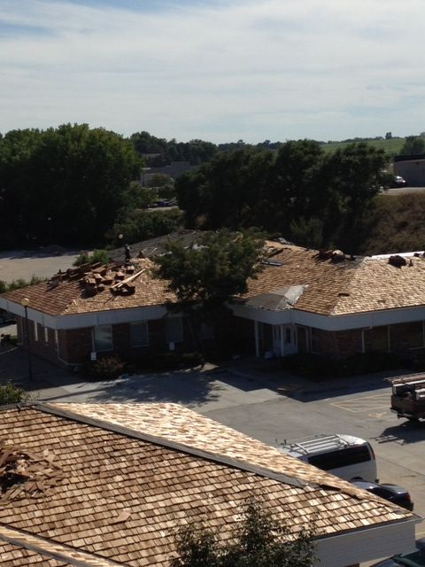 Best Installation Of 600 Squares Of Cedar Shake 1 Grade Blue Label Shingles Five Buildings On One 400 x 300
