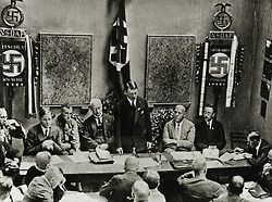 Founding of the Nazi Party in Munich, 1925. From left: Rosenberg, Buch, Schwarz, Hitler, Gregor Strasser, Himmler. Lower right: Julius Streicher