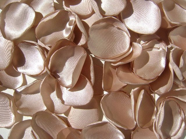 200 rose petals, handmade champagne wedding rose petals, custom colors, artificial satin flower petals. $34.00, via Etsy.