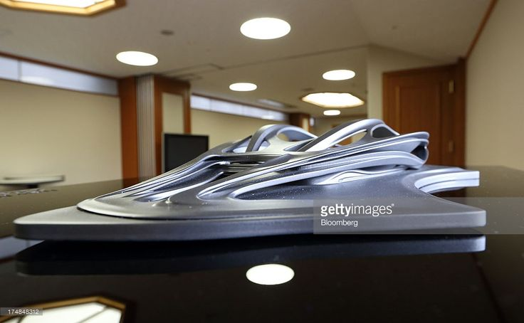 A model of the new National Olympic Stadium, designed by architect Zaha Hadid, stands on display during a media tour for Japan's bid for the 2020 Olympic and Paralympic Games in Tokyo, Japan, on Monday, July 29, 2013. Tokyo, the front-runner city to host the 2020 Olympics, is planning its biggest housing complex in 42 years to lodge athletes, a move that could benefit developers such as Shimizu Corp. and Mitsubishi Estate Co. Photographer: Tomohiro Ohsumi/Bloomberg via Getty Images