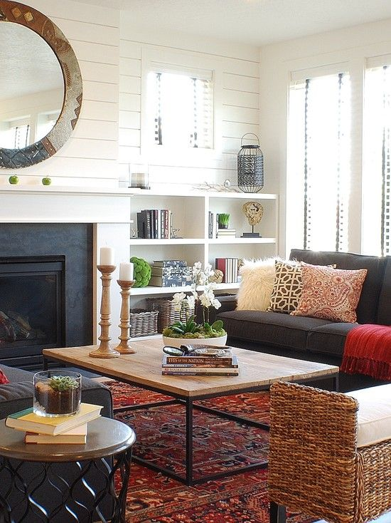 Charming Eclectic Living Room Ideas. Farmhouse Living Room With Black Sofa  And Fireplace Red Rug