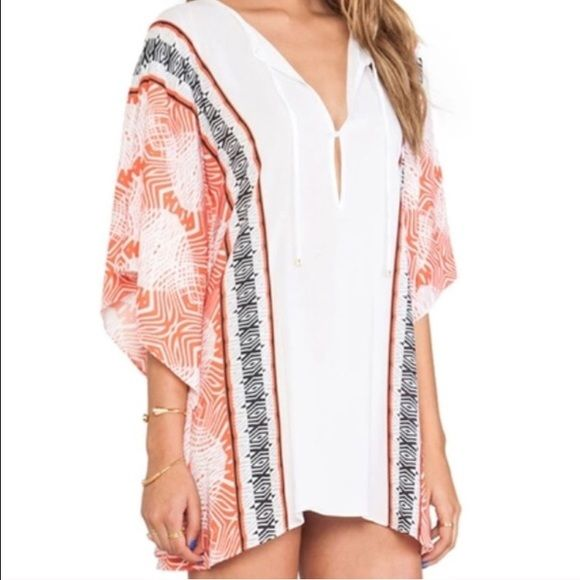 Beach kimono cover up Made of polyester and spandex. It is a sheer material so it is see through. Not listed brand. Instagram: heartofspringboutique San Lorenzo Swim Coverups