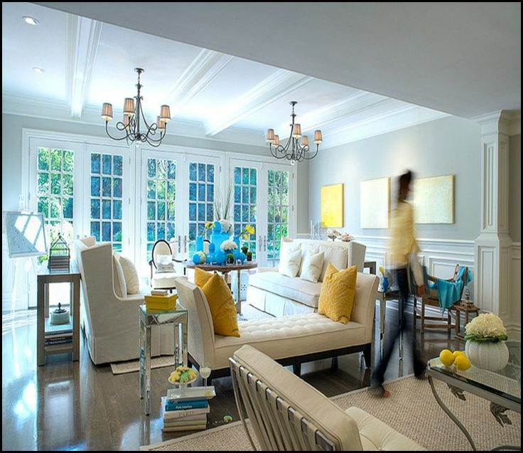 Love the color combo- blue grey walls, white furniture, yellow and black accents!