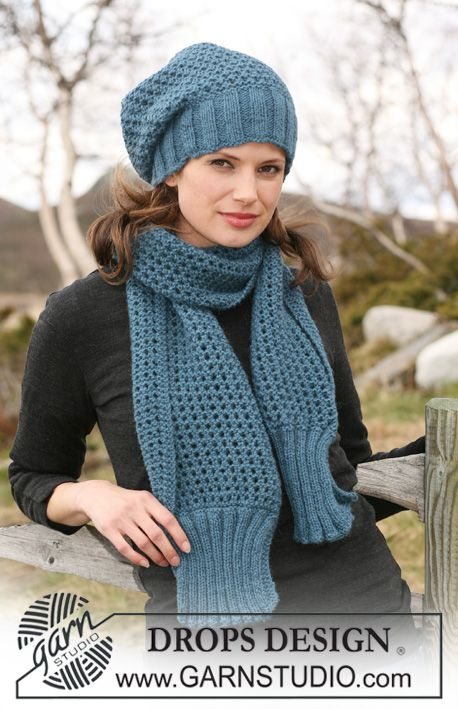 """Set comprises: Knitted DROPS hat and scarf with rib and lace pattern in 2 threads """"Alpaca"""". ~ DROPS Design"""