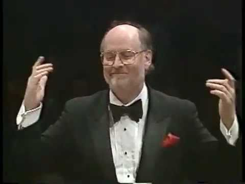 """John Williams conducts the """"Star Wars"""" main theme. Not sure what orchestra it is, but John is conducting :) powerful music!"""