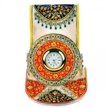 Handcrafted mobile stand engraved in white marble with hand paintings. Beautiful floral designs on mobile stand and studded with stones are done by our experienced artist. These are wonderful return gift for your friends. Its eye catching designs and painting work will be appreciated by your friends.