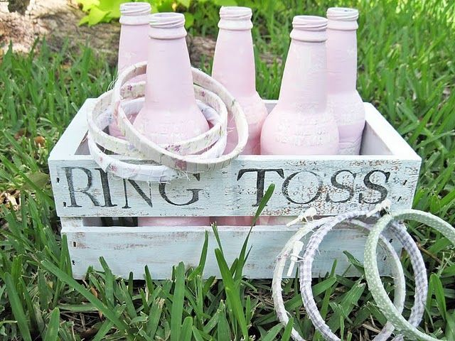 Ring toss game...made from root beer bottles and  small embroidery hoops...too cute!