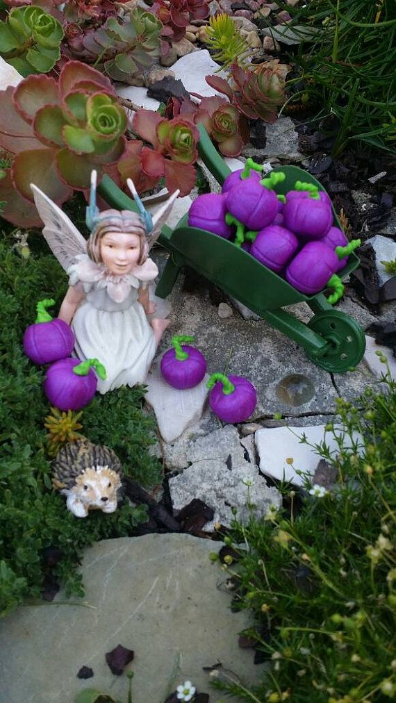 These pumpkins Whimsical Pumpkins are SO FUN for your fairy garden!! They are great for Halloween Villages, Fairy Gardens, Dollhouses, indoor or outdoor! Purple and Green screams Halloween!! Grab a Bunch!! They are made of poly clay, they range in size from 1/2 to 1 1/2. These photos are right from the heart of my Magikal Fairy Village, so they are just representation of what you will receive, however you will receive some very similar. ONLY THE PUMPKINS ARE INCLUDED