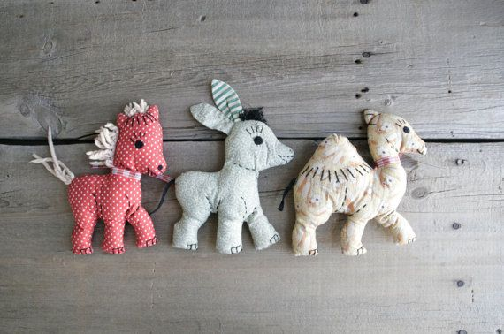 Etsy item: set of three handmade toys from the 1940s, horse, donkey and camel, most likely a first project for a young girl.