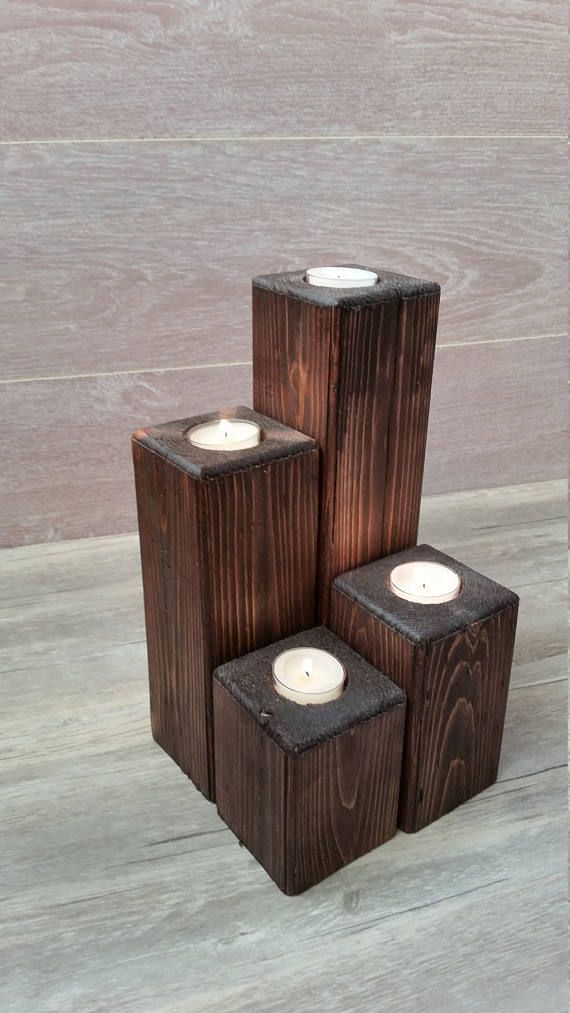 This gorgeous tea light candle holder set is made of real fir wood. It can make a great addition to any room or occasion. It comes in a rich brown walnut stain color. You can use real tea light candles or battery operated would work too. This rustic centerpiece has a texture and