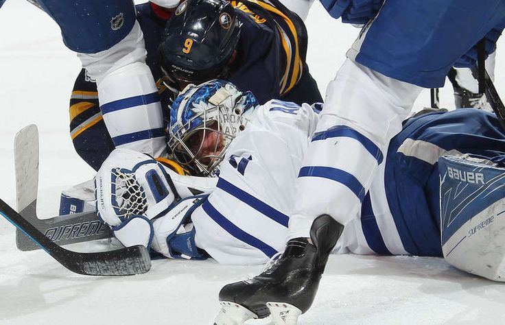 BUFFALO, NY - MARCH 25: Evander Kane #9 of the Buffalo Sabres collides with goaltender Frederik Andersen #31 of the Toronto Maple Leafs during the first period an NHL game at the KeyBank Center on March 25, 2017 in Buffalo, New York. Buffalo won, 5-2. (Photo by Bill Wippert/NHLI via Getty Images)