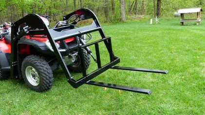 ATV forklift attachment on quad bike. The ATV forklift attaches to the front of your ATV quad bike and is designed to move pallets, lifting, lowering and transporting hay bales, large crates, logs, trees up to 300 pounds. For more info: http://www.fresh-group.com/atv-forklift.html