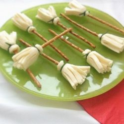 Witch's Brooms made from pretzels and string cheese