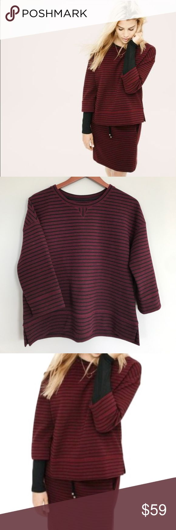 Like New Lou & Grey Ottoman Striped Popover in XS Like New Lou & Grey Crewneck in Wine and Black size XS.  An easy, texture-rich piece for your every day.  Ottoman ridges take touchable texture to a whole new level.   Can be layered during the cold winter months!  - Crew neck - 3/4 sleeves - Drop shoulders - Side slits - Banded neckline, cuffs and hem  Thick and soft. Fits TTS. Materials tag pictured. Machine Washable.   Accepting offers on this item. Happy to take measurements and answer…