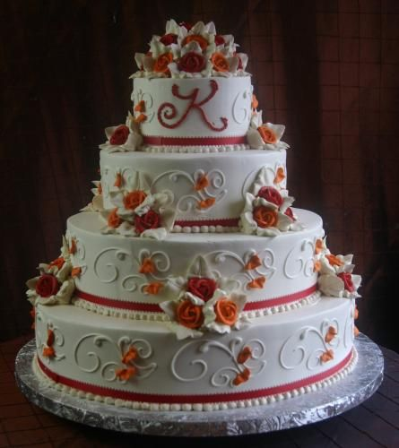 Red and orange . . . or my monitor might be kind of questionable, so maybe it's dark pink and orange. Either way, pretty! (Konditor Meister Elegant Wedding Cakes)