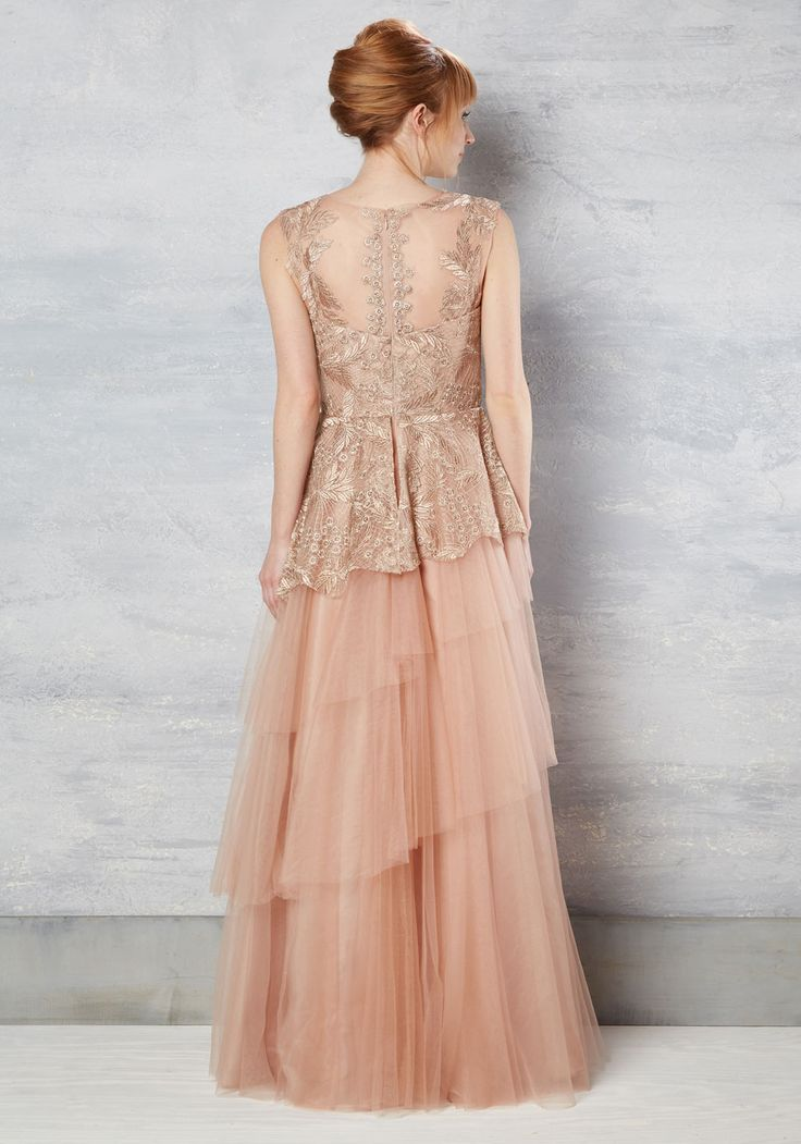 Every set of eyes at the gala will enliven at the sign of your statement gown! Its tasteful taupe hue is sweetened with a rosy tint and is embroidered with metallic threads at the illusion neckline, bodice, and top skirt tier. Vivified with a tutu-inspired skirt, this fancy dress arouses conversation over your style excellence!