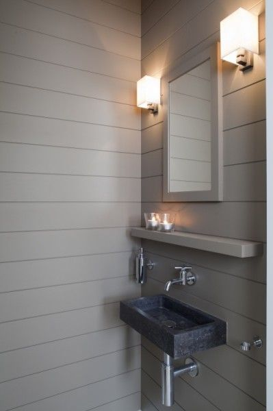 Fabulous small bathroom! SO beautifully done. The grey panelled walls and feature lights are stunning.