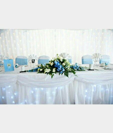 Blue wedding top table decorations fairy lights