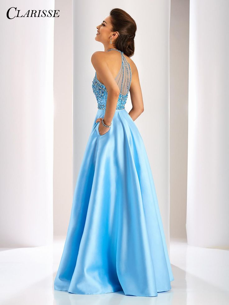Clarisse full a-line prom dress with sparkly bodice and pockets! Feel like a princess in this gorgeous halter ballgown with a beaded bodice, sheer mesh back, and Mikado skirt with pockets. Click through to find your authorized Clarisse retailer today! COLOR: Periwinkle SIZE: 0-20