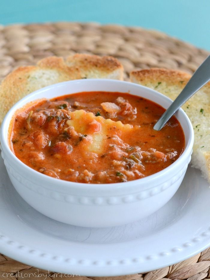Recipe for hearty Tuscan Soup with Ravioli. Hearty and flavorful, and perfect served with garlic bread for dipping!