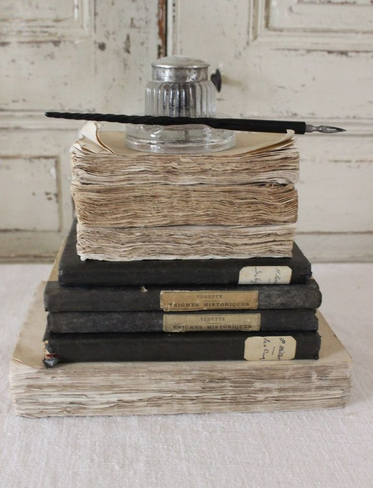 Ink pots, quill & vintage books