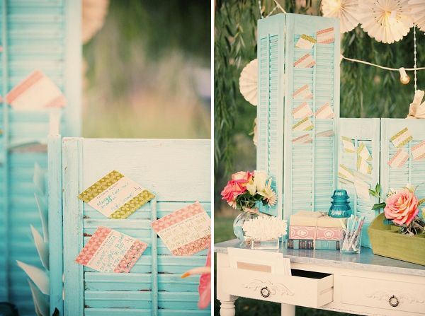 This bride painted old shutters and used them as a display for her place cards!  Genius! (and the aqua, rose, green and ivory color combo is especially dreamy!)  vintage wedding. outdoor wedding. wedding color idea.