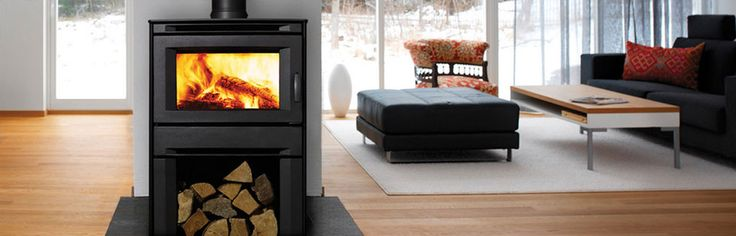 Regency Wood Heater: ALTERRA MEDIUM WOOD FREESTANDING - A wood burning stove with modern appeal! The contemporary design of Regency's Alterra wood stove puts the focus on the brilliant glowing fire. With an impressive viewing area, and a convenient firewood storage area, the Alterra is perfectly proportioned for visual pleasure and functional convenience. #Heating #WoodFire #Freestanding #Regency #HearthHouse