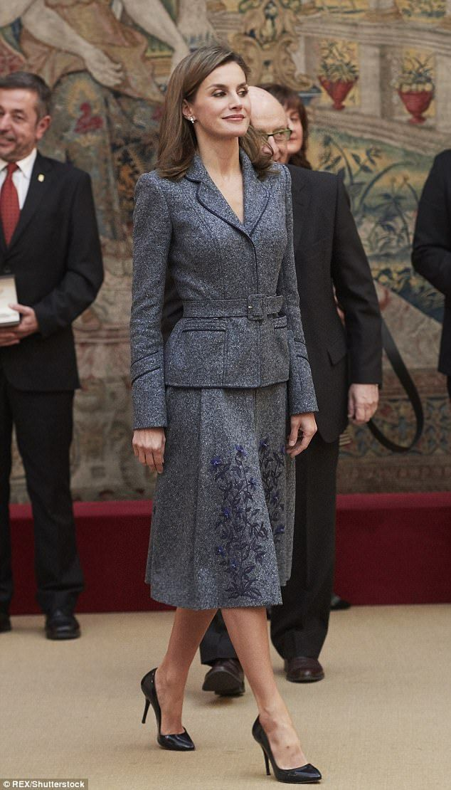 The Spanish Queen looked sharp in a grey tweed belted jacket and knee-length skirt, which ...