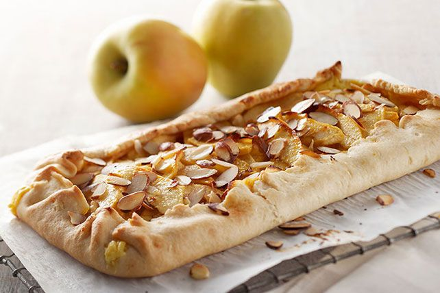 It must be the crisp air of the orchard that makes us want to mold a rustic, fresh fruit tart by hand. This one sports lemony cream cheese along with crisp apples.