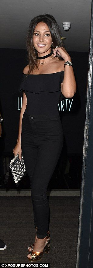 Looking great: The 28-year-old beauty highlighted her slender figure in Bardot style top which she teamed with black skinny jeans