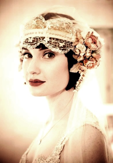 Bride's 20's flapper Gatsby bandeau  flowers short wedding hairstyles