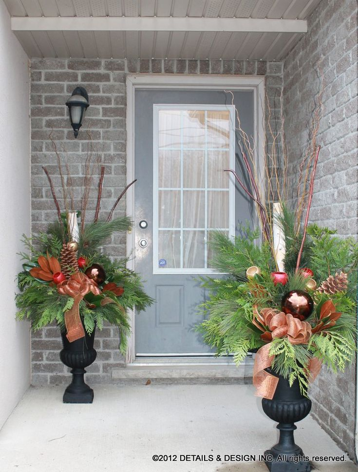 staggered Christmas urn arrangements for when space is tight