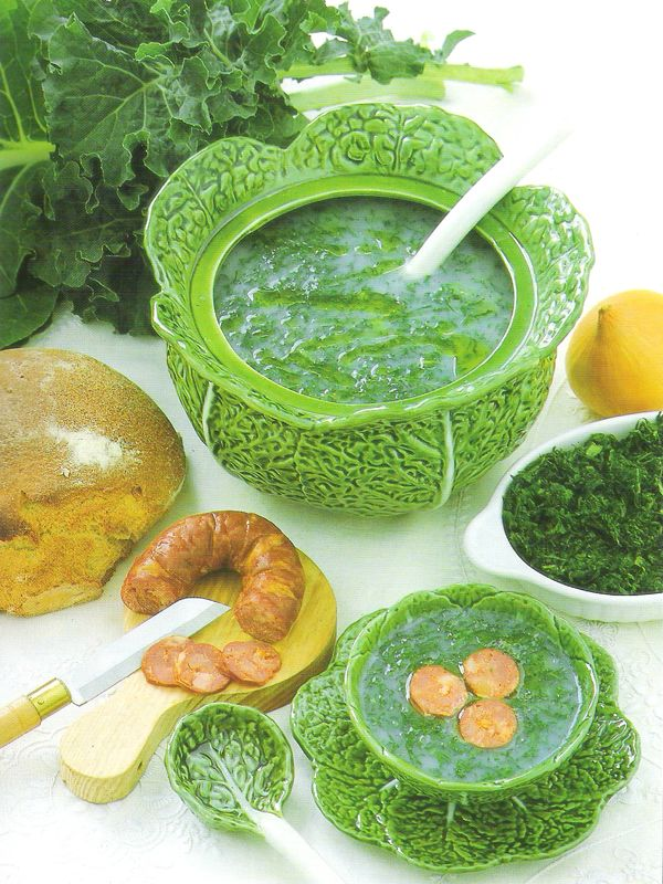 Caldo Verde Soup served in a cabbage shaped soup terrine. The soup bowls are also cabbage shaped.