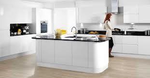 white high gloss kitchen, wooden floor, black worktop w splashback. Yellow accent