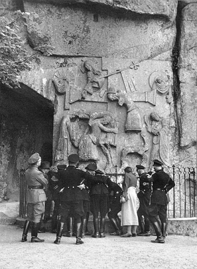 "Himmler and party examine a bas-relief at the Externsteine, a rock formation in northwest Germany with ritualistic associations. ""Nazism needed a state religion,"" Heather Pringle wrote in The Master Plan: Himmler's Scholars and the Holocaust. ""And it needed a god, or perhaps several gods, as well as suitable rituals to take the place of Mass and other Christian services. 'After the war,' he explained, 'the old Germanic gods will be restored.' """