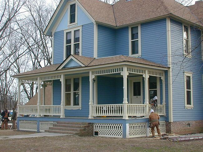 Blue victorian house is scraped and repainted i love the for Side porch designs