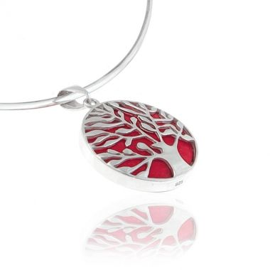 A 925 sterling silver pendant featuring a red coral gem set in a Tree of Life silver design. Symbol of life and wisdom in ancient Greek mythology, this inspiring and magnificent red coral silver pendant, is sure to make an eye-catching impression. It is reversible to show the red coral stone only so you can make versatile appearances. Match it beautifully with red coral silver sterling earrings to create an elegant casual look.
