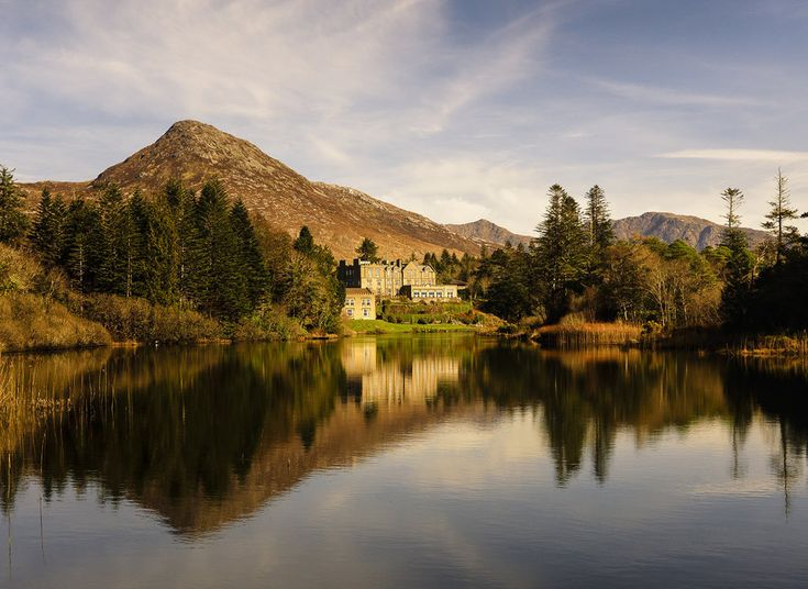 Ballynahinch Castle Hotel Recess, Ireland water sky outdoor Lake reflection Nature River tree landform geographical feature wilderness body of water plant autumn season leaf morning woody plant landscape loch mountain rural area pond reservoir surrounded waterway cattle flower