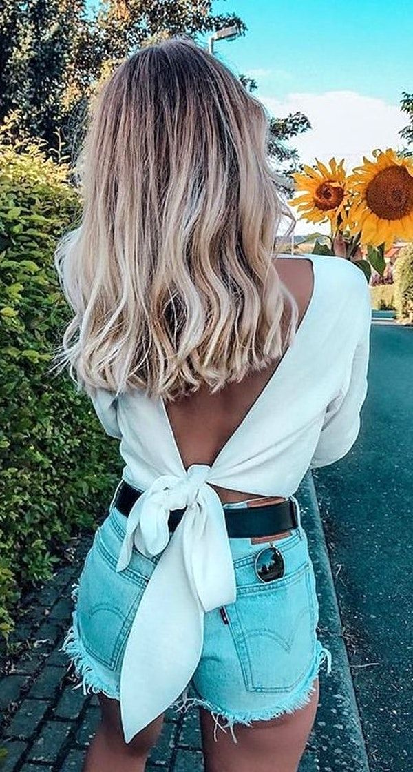 #fall #outfits women's white backless shirt and blue shorts