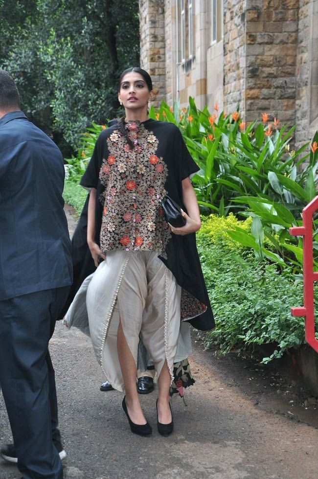 Sonam Kapoor spotted in an Anamika Khanna Couture cape teamed up with draped/dhoti pants. #Bollywood #Style #Fashion
