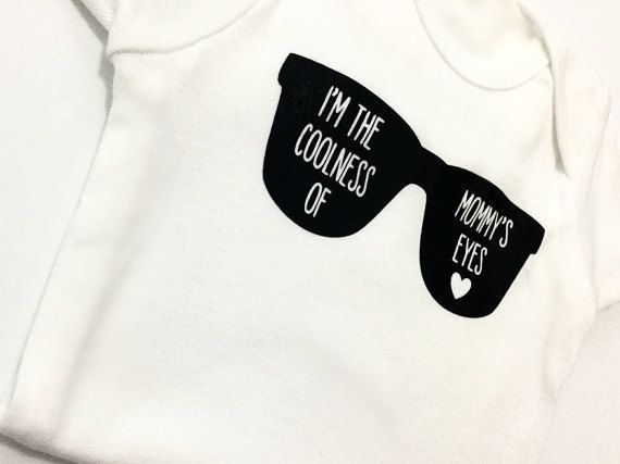 A cute addition to a wardrobe or adorable for gift giving! Have the little one make a statement with what they wear!  This super comfy onesie is available in short and long sleeve bodysuits in sizes newborn to 24 months. The size and length of sleeves can be selected using the size drop bar menu. **If you would like to change the word mommy to another title, please clearly let us know in the notes to seller section.  The colour options for the image can be seen and selected using the colour…